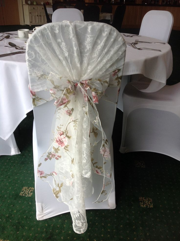 Beautiful vintage lace chair hood with floral organza sash