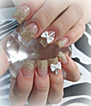 gold and 3d bows acrylic nails