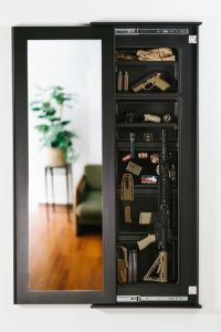 Built in and hidden gun cabinet kit that looks like a ...