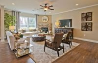 Transitional Living Room with metal fireplace, flush light ...