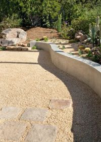 Curved concrete seat wall - stone pavers - seat wall ...