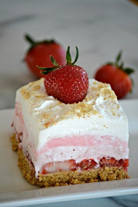 These Strawberry Cheesecake Dream Bars are layers of graham crackers, strawberries, and more. It's the perfect NO-BAKE dessert for