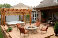 hot tub and stone firepit on deck. like the pergola