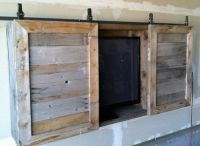 Outdoor TV cabinet...the barn doors might be a good idea ...