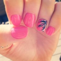 Pink shellac nails with line design.