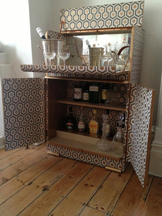 Vintage Cocktail Cabinet Covered in Cole  Son Wallpaper