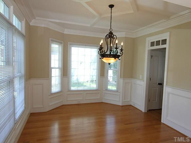Dining room with bay window wainscoting and custom ceiling treatment  Walls and Mantels