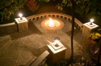 Beautiful night shot of fire pit, paving stone patio and