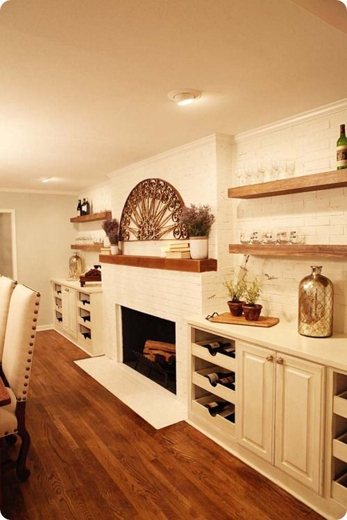 dining room wall built ins and raw wood shelves match mantle in family room to shelves