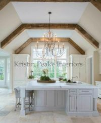 Elegant kitchen with vaulted ceilings lined with rustic ...