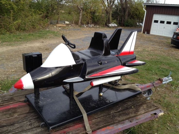 Coin operated kiddie ride jet fighter airplane rocket good