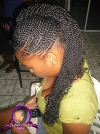 Natural hair protective style: small cornrows with ...