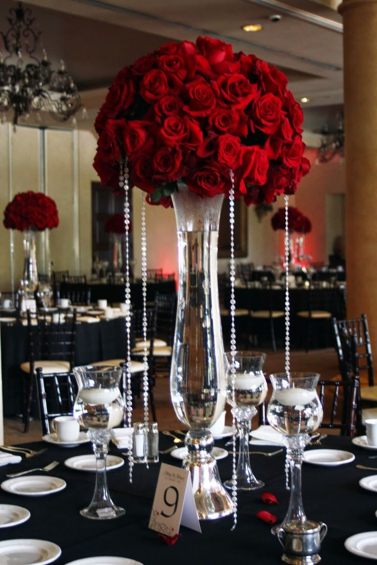 tall red rose wedding centerpieces  Beautiful red rose centerpieces dripping in bling adorned