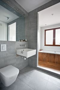Grey tiled bathroom.