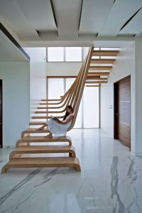 Sculptural Staircase Defines A Modern Two-Storey Apartment ...