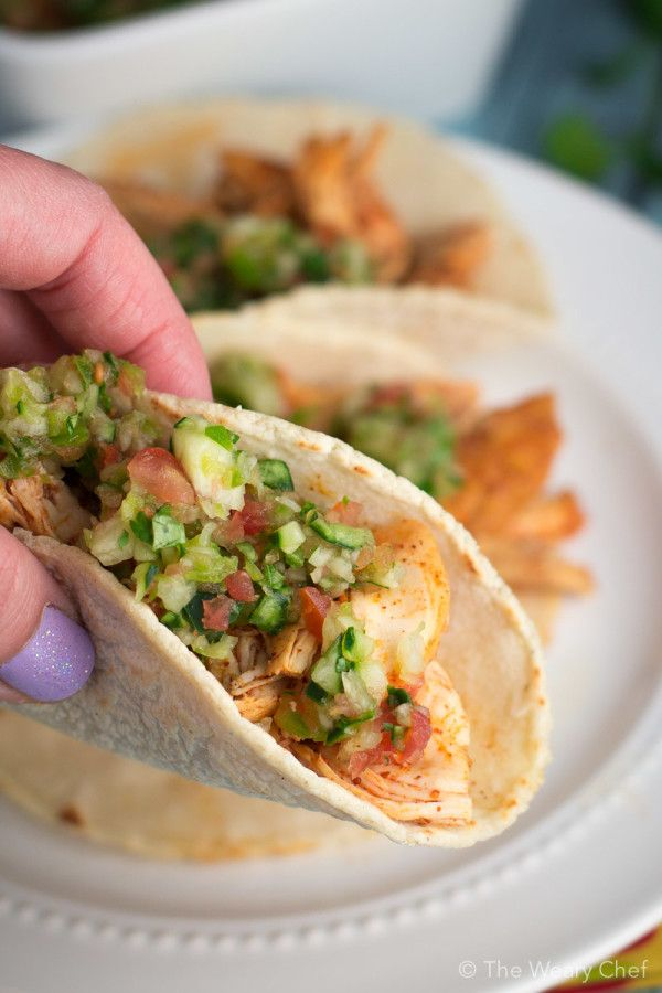 Tender margarita chicken marinated in tequila, lime juice, and spices is perfect to fill your tacos!
