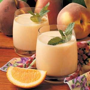 Peach Smoothies-2 cups milk  2 cups frozen unsweetened sliced peaches  1/4 cup o