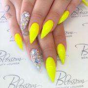 neon yellow stiletto nails