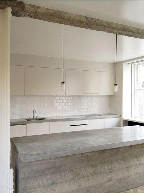 white. details i love: wooden beam; concrete counters, subway tile, gas light pendant, industrial stools, chevron wood floors.