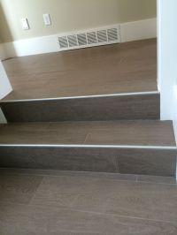 Wood floor tile on stairs with metal end cap | Painted ...