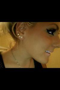 Triple helix. Love her other lobe piercings too ...