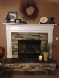 Air stone fireplace with slate. Mixed autumn mountain and ...