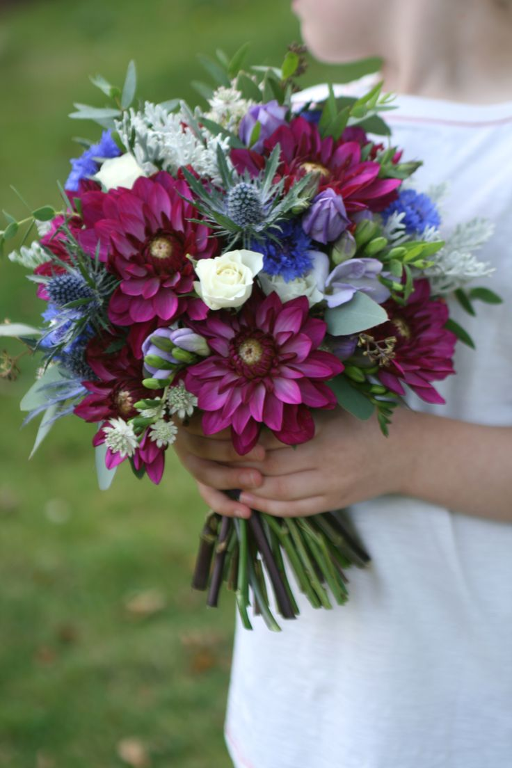 Wedding bouquet in burgundy blue lilac and white including dahlia thistles cornflower and
