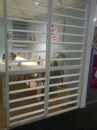 Burglar bars designed to look like shutters! So clever ...