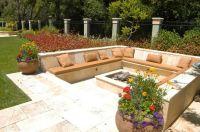 Travertine patio with raised planters and pots creates ...
