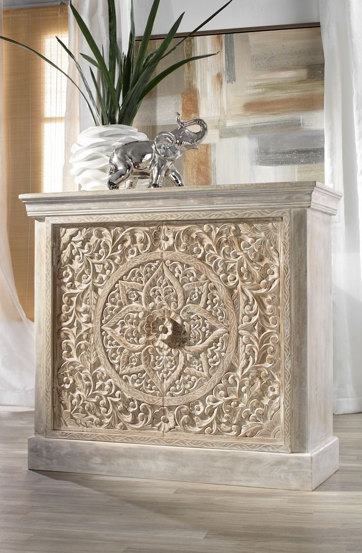 Our NEW handcarved Sanctuary Cabinet is constructed of mango wood and lightly whitewashed to