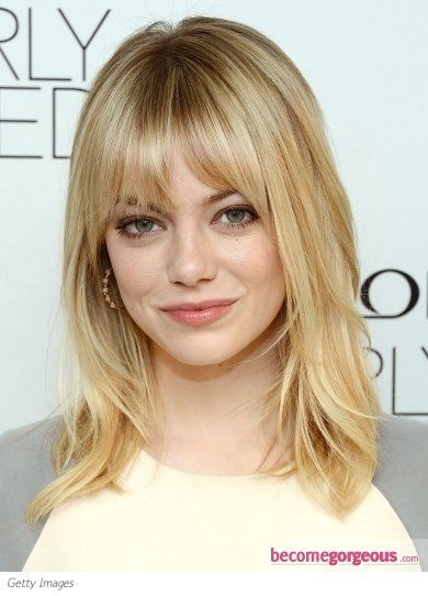 Emma Stone wears her should