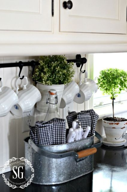FARMHOUSE KITCHEN -white coffee cups and galvanized caddy for utensils and napkins: