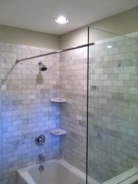 This Tub shower benefits from a Glass Splash panel as well ...