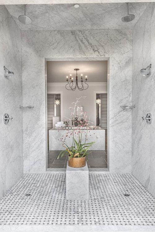 Shower The Walk In Shower Features Marble Slab Walls And Marble Basketweave Mosaic Tile Floors