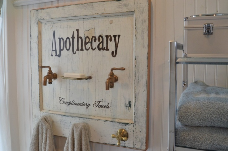 Apothecary bath towel rack made from a vintage door