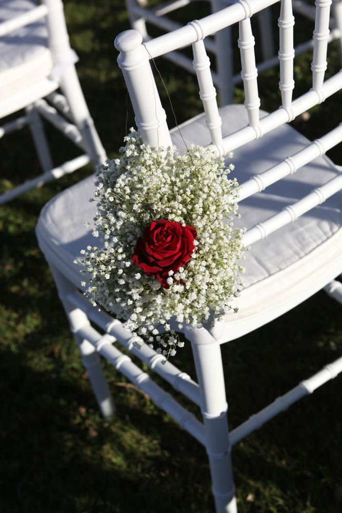 Guests chairs with white gypsophila and Maranello red rose michelazucchini   Styling ideas