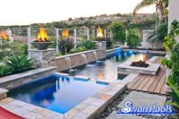 Geometric swimming pool and spa installed with fire bowls