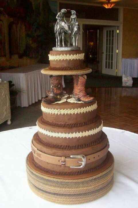 Horse Lovers Country Cowboy 5tiered wedding cake with cowboy boots and the bride and groom