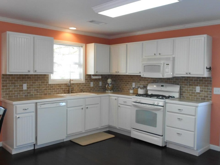 Peachy Keen wall color against Bisque appliances and ivory