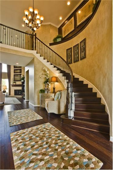 Love the curved staircase and sitting area at the base of
