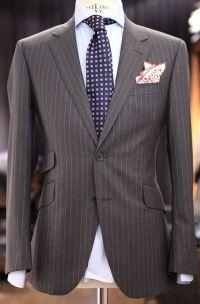 Grey pinstripe suit, light blue striped shirt, purple tie ...