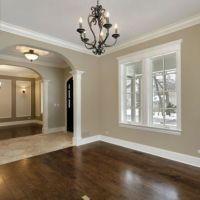 Dark wood floors and white baseboards/ window trim ...