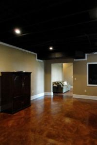 Stained concrete sprayed black ceiling