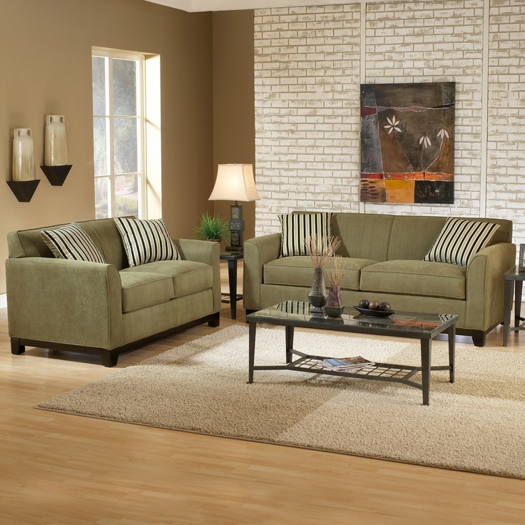 Sage green couch, neutral rug