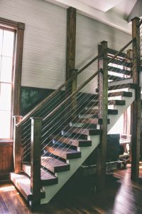 gorgeous wooden staircase, wood posts and top rail with