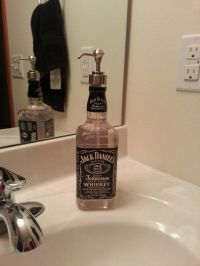 Upcycling... used empty jack daniels bottle for soap ...