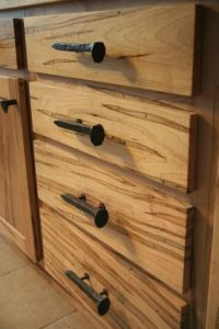 cool cabinet pulls...but RR spikes...does that really go ...