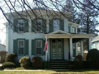 white house with green shutters and trim -- very classic ...