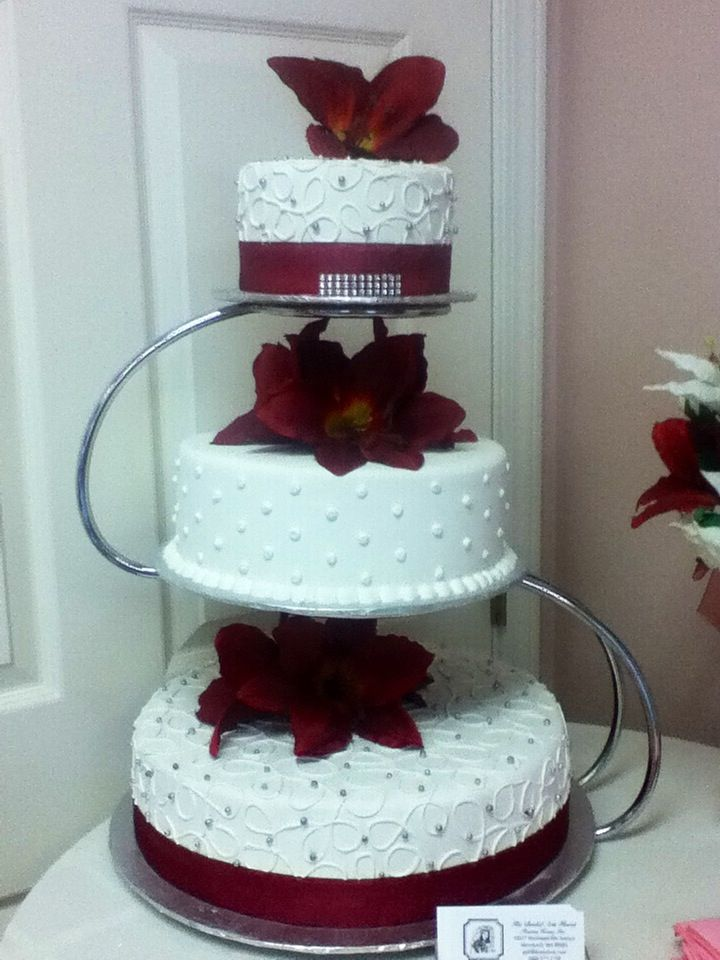 My Wedding Cake With Red Lillies Color Scheme Is Burgandy