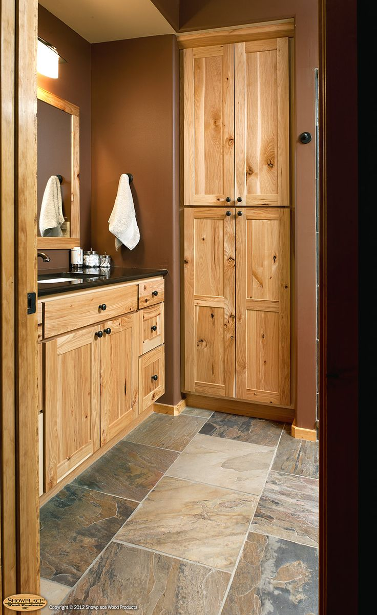 rustic hickory bathroom vanity  Cabinets Rustic hickory appears again in this lowerlevel bath